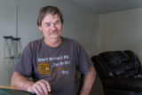 Donald Meade, 52, at his apartment in Fullerton, Calif., on February 13, 2016. Meade, a recipient of the Illumination Foundation's housing-first program, has battled addiction, cancer and chronic heart problems that fueled recurring visits to the emergency room. (Heidi de Marco/KHN)
